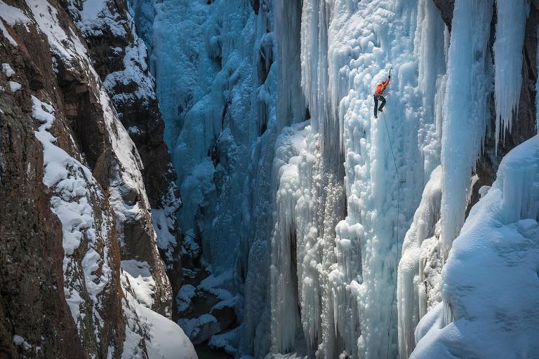 Dawn Glanc climbing a WI 5 pillar in the Ouray Ice Park in Ouray, Colorado.