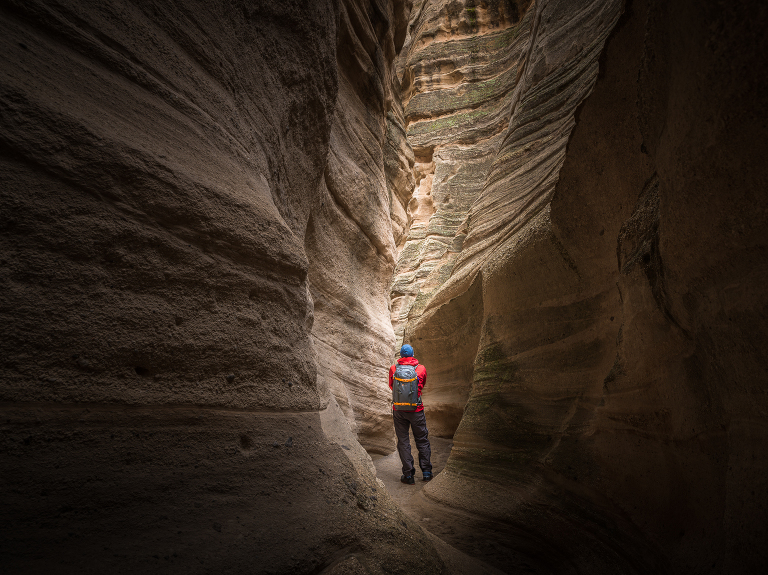 Michael Clark navigating a narrow path in Kasha-Katuwe Tent Rocks National Monument near Chochiti, New Mexico.