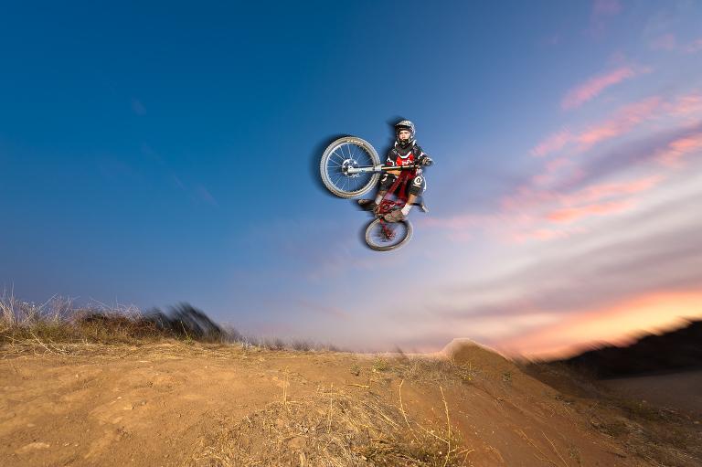 Anthony Solesbee downhill mountain biking near Lake Elsinore, California.